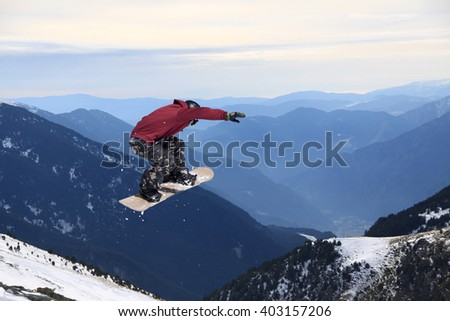 Snowboarder jumping on mountains. Extreme sport. #403157206