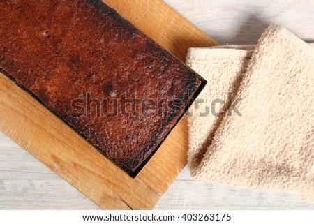 Freshly baked raisin butter cake in loaf tin #403263175