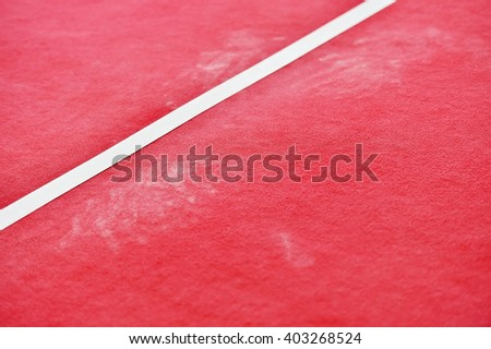 Detail shot with red gymnastics floor and traces of chalk