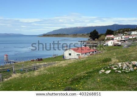 HARBERTON, ARGENTINA - NOVEMBER 16,2014:Harberton estate is the oldest farm of Tierra del Fuego and an important historical monument of the region. #403268851