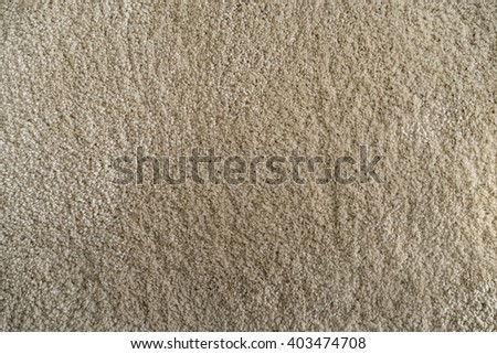 Light gold brown carpet fabric background and texture. #403474708