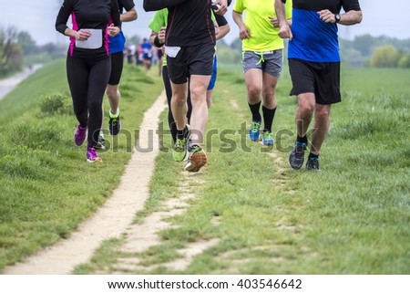 Outdoor marathon cross-country running fitness and healthy lifestyle #403546642
