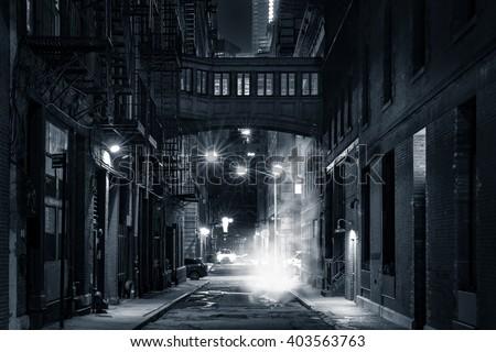 Moody monochrome view of Staple street skybridge by night, in Tribeca, New York City #403563763