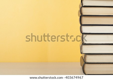 Stack of colorful books on table. Education background. Back to school. Copy space for text. #403674967