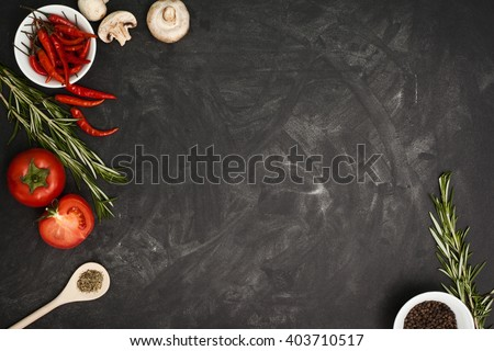 Black table with food ingredients and utensil, top view frame style #403710517