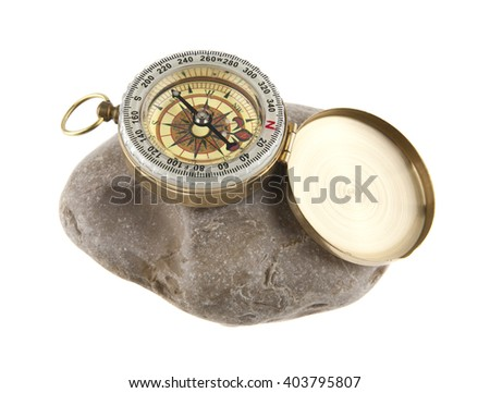 compass on a stone isolated a white background #403795807