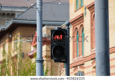 Red traffic light sign - combined bicycle and pedestrian traffic light in Budapest, Hungary #403826335