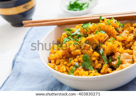 biryani chicken rice fried in bowl with chopstick #403830271