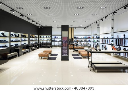 bright and fashionable interior of shoe store in modern mall Royalty-Free Stock Photo #403847893