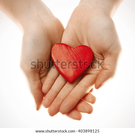 Decorative heart in female hands, isolated on white #403898125