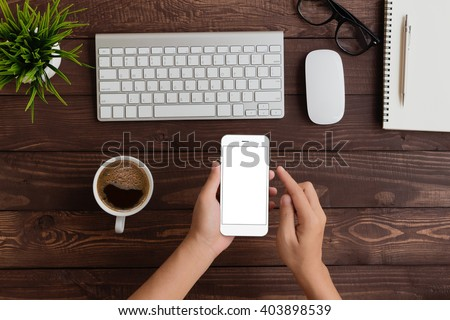 hand use phone blank screen top view Royalty-Free Stock Photo #403898539