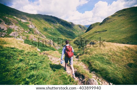 A hiker walking in the English Lake District, UK. #403899940