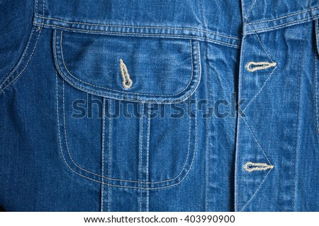 Casual blue Denim jacket close up detail. Fashion, textures and backgrounds #403990900