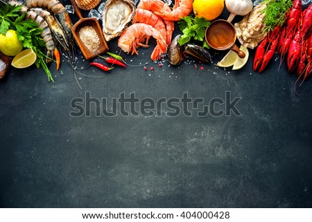 Shellfish plate of crustacean seafood with shrimps, mussels, oysters as an ocean gourmet dinner background #404000428