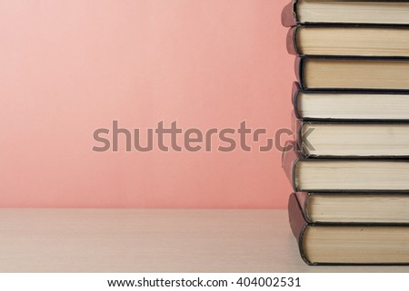 Stack of colorful books on wooden table. Education background. Back to school. Copy space for text. #404002531