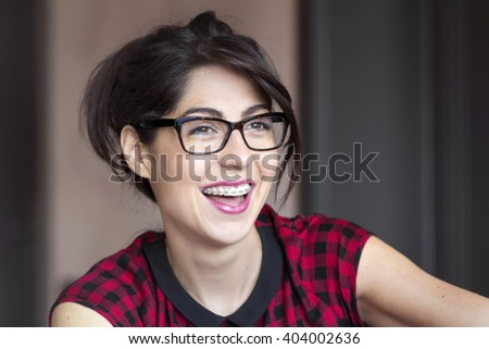Portrait of a beautiful woman with braces on teeth. Orthodontic Treatment. Dental care Concept #404002636