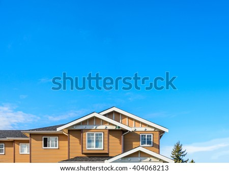 The roof of the house with nice window. #404068213