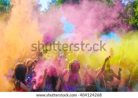Vitebsk, Belarus - July 4, 2015: Throwing color at the Holi color festival #404124268