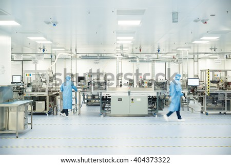 High-tech machinery and technology equipment in in sterile factory hall for producing high-tech car and jet modules and high-end component, Plovdiv, SENSATA Bulgaria, April 08, 2016. #404373322