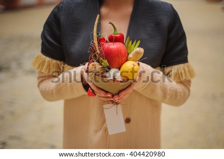 The original unusual edible bouquet of vegetables and fruits on  wood  #404420980