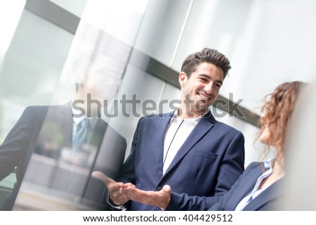 business people group meeting pointing something in front of the office window, asian people,european #404429512
