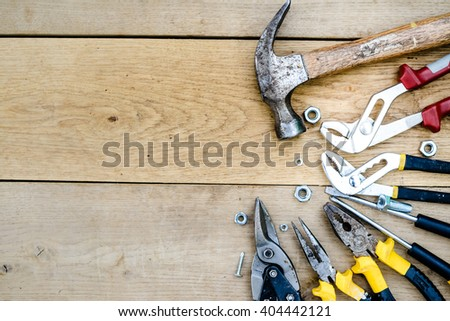 Closeup flat lay of tools on a wooden surface texture #404442121