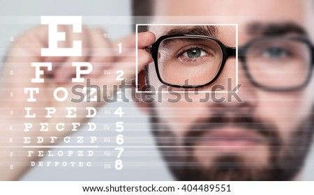 Male face and eye chart. Eyesight concept #404489551