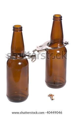 Concept image of getting arrested while being drunk, shown with two beer bottles with handcuffs on #40449046