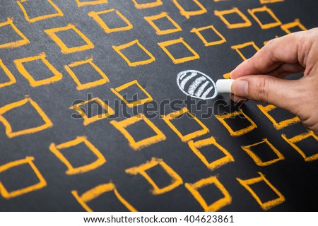 Hand drawing circle among square boxes, find your positioning, niche, or differentiation concept Royalty-Free Stock Photo #404623861