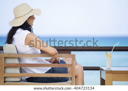 A woman relaxing with a drink #404723134
