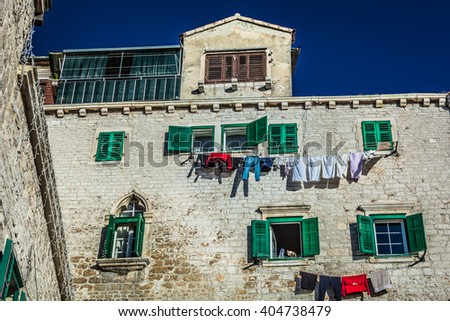 Great example of traditional mediterranean architecture in town Sibenik on Adriatic sea, in Croatia. / Traditional architecture in Croatia. #404738479