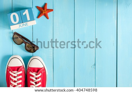 June 1st. Image of june 1 wooden color calendar on blue background.  First summer day. Empty space for text. Happy Childrens Day #404748598