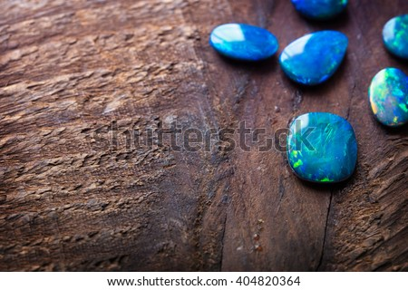 Blue Opals on rustic wooden table. Shallow depth of field.