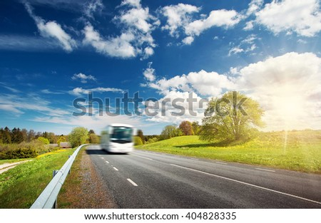 Bus on asphalt road in beautiful spring day at countryside #404828335