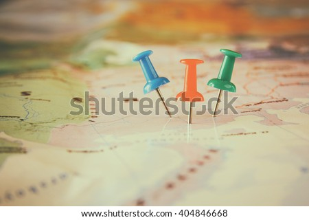 pins attached to map, showing location or travel  destination . retro style image. selective focus. Royalty-Free Stock Photo #404846668