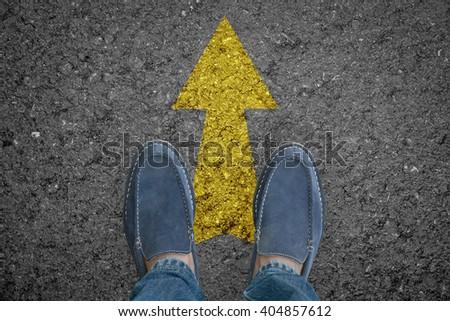 Man feet walking on asphalt road with arrow choice concept. #404857612