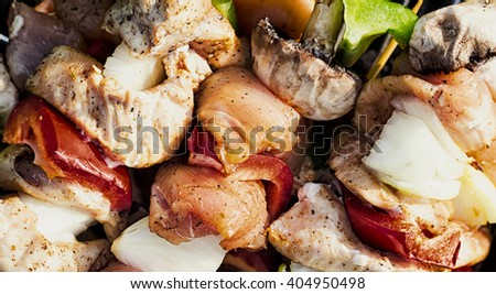 Grilling shashlik on barbecue grill #404950498