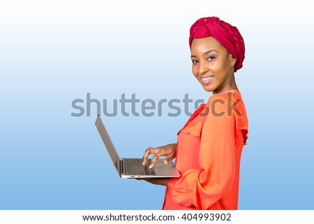 African american woman holding laptop #404993902