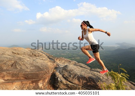 young asian woman runner running on mountain peak   #405035101