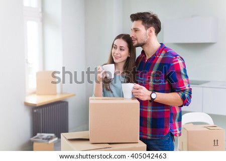 Couple with unpacked boxes in new home #405042463