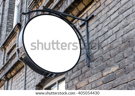 Photo blank white mockup of street store vintage signboard on an old yellow brick wall