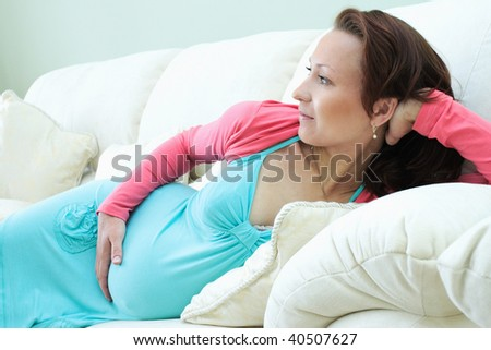 Nine month pregnant beautiful woman holding her belly #40507627