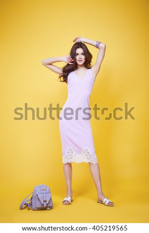 Beautiful glamour sexy woman dark brunette hair wear long silk or cotton fashion dress hold hand lather bad shoes sandals natural beauty makeup perfect body shape clothes for meeting walk party date #405219565