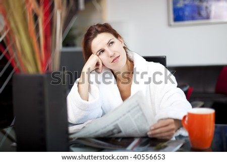 women reading the morning paper wondering about the future #40556653