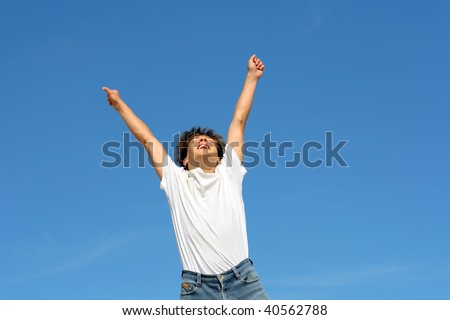 happy teenager jumping on blue sky background #40562788