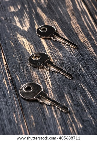 Three key from the door on a dark wooden background #405688711