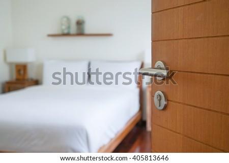 opened wooden door with blurred bedroom #405813646