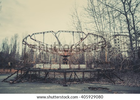 Abandoned carousel at an amusement park in the center of the city of Pripyat, the Chernobyl disaster, the exclusion zone, a ghost town #405929080