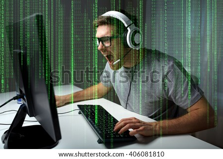 technology, gaming, entertainment, let's play and people concept - angry screaming young man in headset with pc computer playing game at home and streaming playthrough or walkthrough video #406081810
