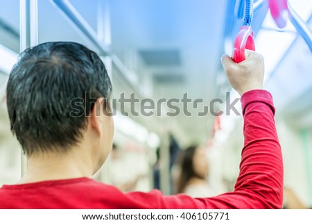 man's hand holding a handle on train #406105771